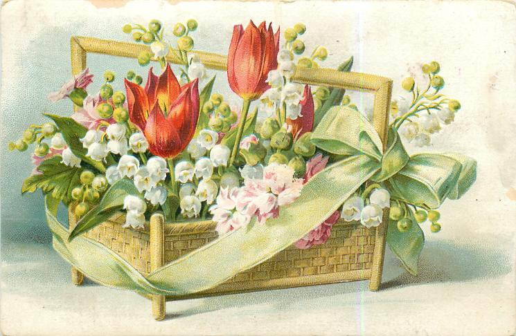 tulips, lillies-of -the-valley & others in oblong yellow wicker basket on legs, green bow
