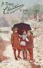 three children under umbrella, one holds snowballs