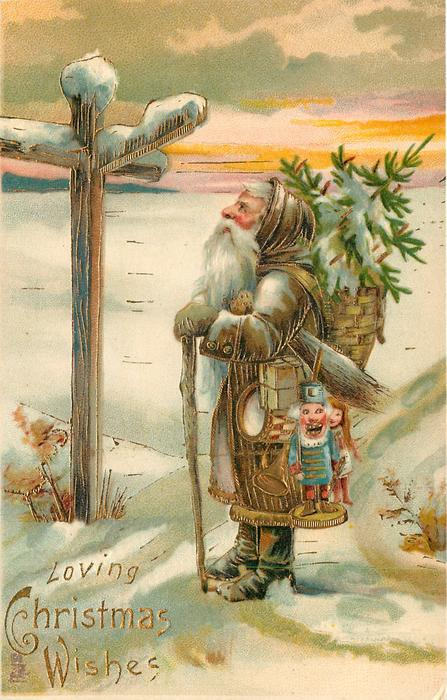 LOVING CHRISTMAS WISHES, brown robed Santa with toys looks up at snow covered signpost