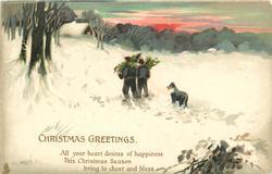 CHRISTMAS GREETINGS  two people carrying wood walk away, dog follows