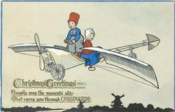 CHRISTMAS GREETINGS  two Dutch children fly airplane
