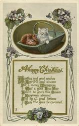 A HAPPY CHRISTMAS  two kittens, one brown one white, in basket, blue violets