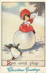 RUN AND PLAY  girl sits on large snowball & snowballs penguin