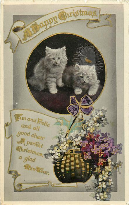A HAPPY  CHRISTMAS  inset of two kittens above basket of violets