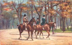 two male riders follow lady right