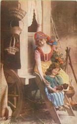 gypsy woman sits on caravan step, girl with teddy in arms sits on step below, both look at bear