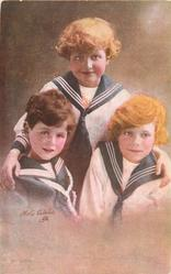 three boys in sailor suits, boy front left looks front, boy on right looks up /right,boy at back looks up/right