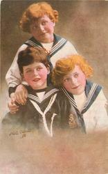 three boys in sailor suits, boy front left looks front, boy on right looks front, boy at back looks front