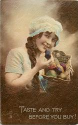 TASTE AND TRY BEFORE YOU BUY!  woman cradles basket of fruit & looks front holding up an avacado