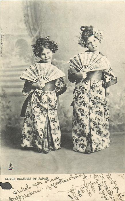 LITTLE BEAUTIES OF JAPAN  two white girls in kimonos hold fans at chest level