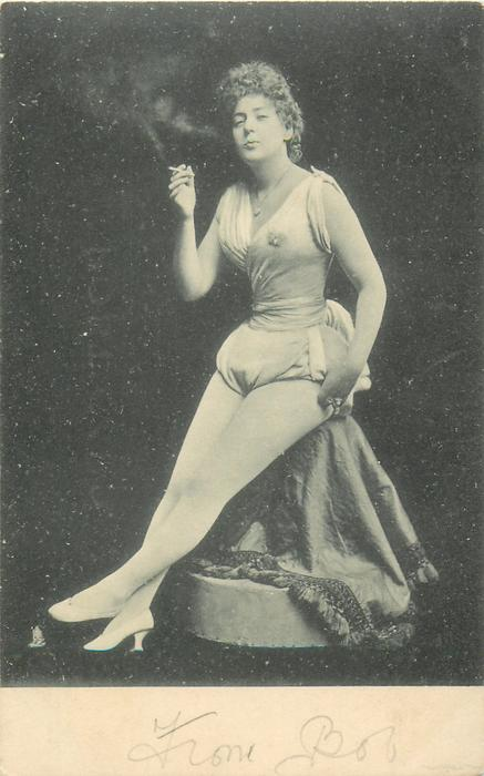 woman in circus attire sits smoking