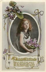 A HAPPY CHRISTMAS  girl holds a basket of purple forget me nots, violets around