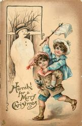 HURRAH! FOR A MERRY CHRISTMAS  young boy carries girl piggy-back past snowman
