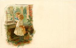 boy and girl in front of bird cage
