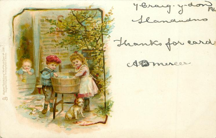 two children by washing tub, baby in doorway