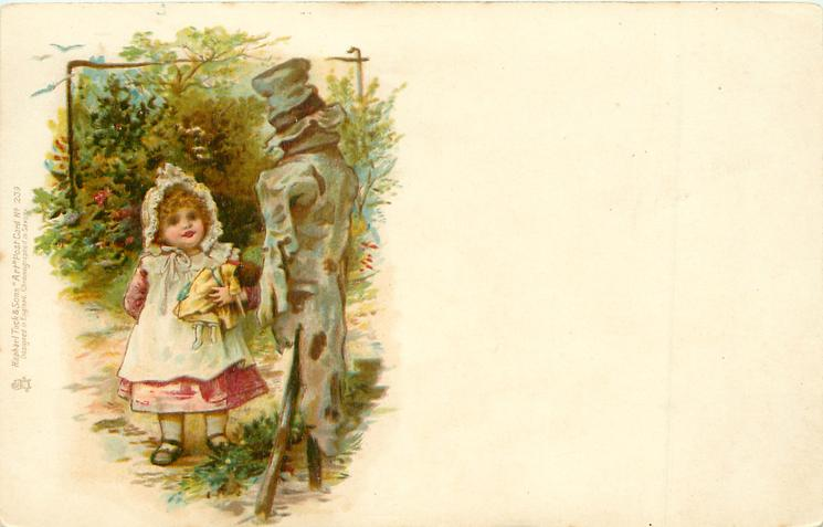 girl with doll looking at scarecrow