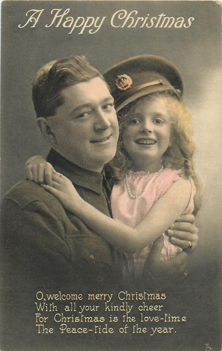A HAPPY CHRISTMAS  soldier left, girl wears his cap and embraces him, both look front