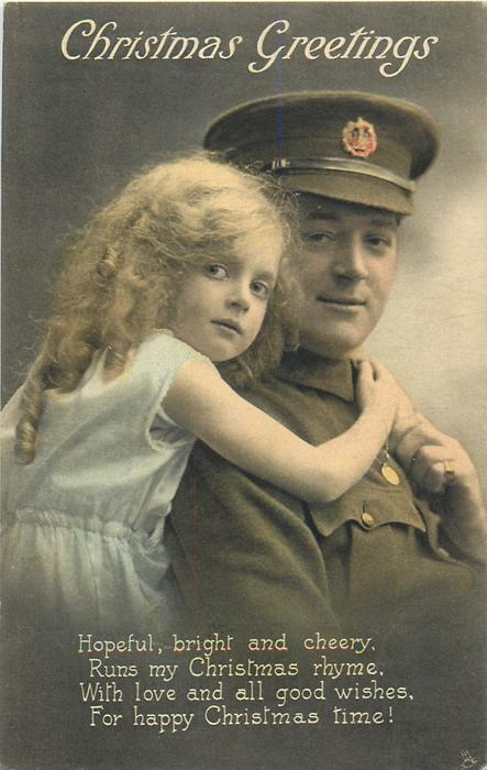 CHRISTMAS GREETINGS  soldier right wears cap, girls arms embrace him, both look front