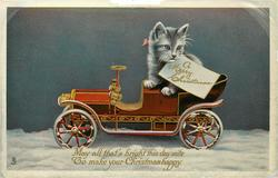 A MERRY CHRISTMAS (on card)  kitten in toy car