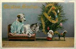 CHRISTMAS GREETINGS  dressed kitten & puppy in bed, tree right