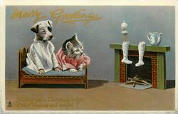 MERRY GREETINGS  dressed kitten & puppy in bed, fireplace, stockings right