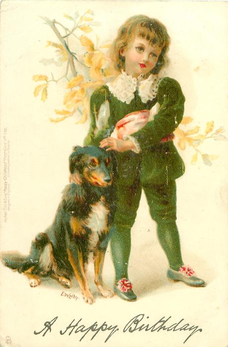 boy in green suit, with dog