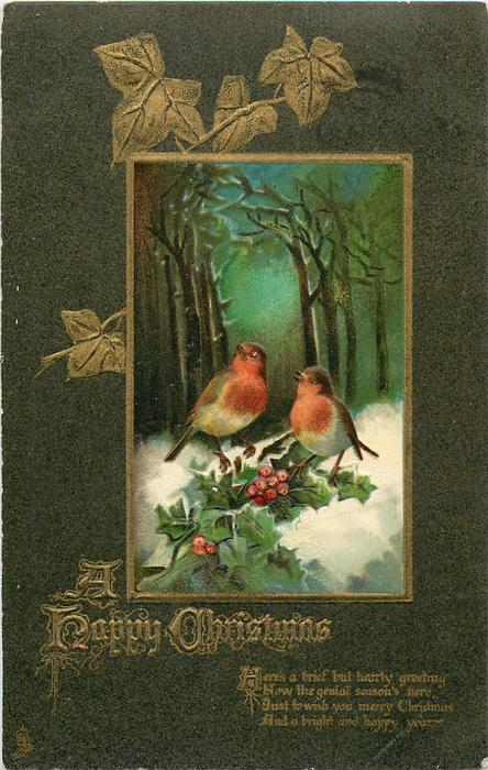 A HAPPY CHRISTMAS  two robins perch on holly, snowy woods