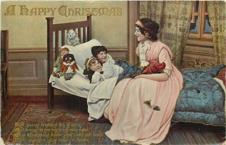 A HAPPY CHRISTMAS  mother sits on bed, two children, toys & golly