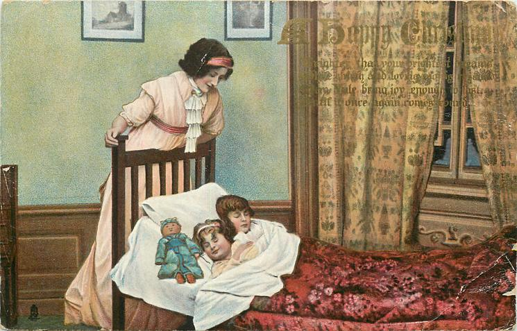 A HAPPY CHRISTMAS  mother looks down on two sleeping children