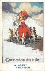A MERRY CHRISTMAS (in blue at base)  girl with parcel surrounded by rabbits