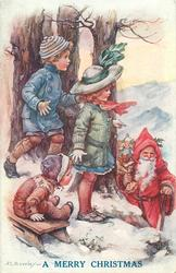 A MERRY CHRISTMAS or HEUREUX NOEL  three children watch Santa come up hill