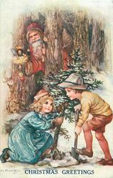 CHRISTMAS GREETINGS  or HEUREUX NOEL Santa watches two children dig up Xmas tree