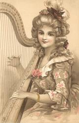 woman leans harp on her right shoulder and plays it with her hands