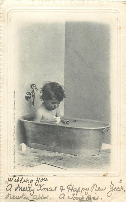 boy in tub playing with toy bird
