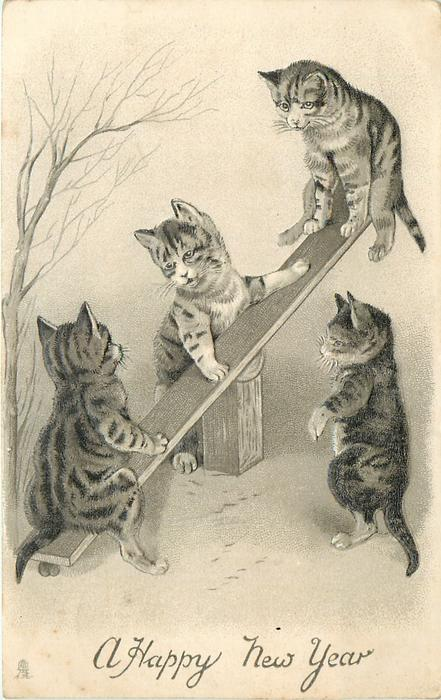 four kittens with see-saw