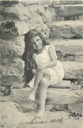 barefoot young girl sitting on stone step, legs crossed, two boards under her, left hand on left knee