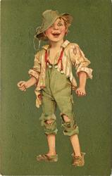 Irish boy dressed in green with red suspenders and holes in pants