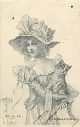 pretty girl holding cat on lap, large hat with bows