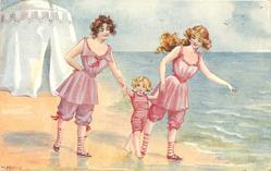 two bathing girls in pink, leaving beach tent with child in striped pink
