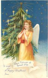 GOOD TIDINGS OF GREAT JOY, angel in orange dress praying & Xmas tree