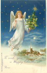 angel in white flying & carrying small Xmas tree, church & wintery scene below