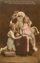 Santa seated in chair, boy on his right & girl on his lap
