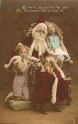 Santa seated in chair, boy & girl on either side, boy holds trumpet