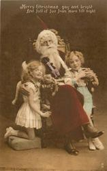 Santa seated in chair, boy right & girl left, boy holds a toy