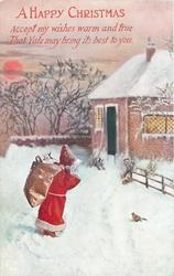 A HAPPY CHRISTMAS Santa carrying sack, house back/right