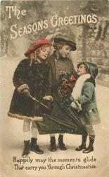 THE SEASONS GREETINGS  2 girls and boy talk in snow,  one holds umbrella