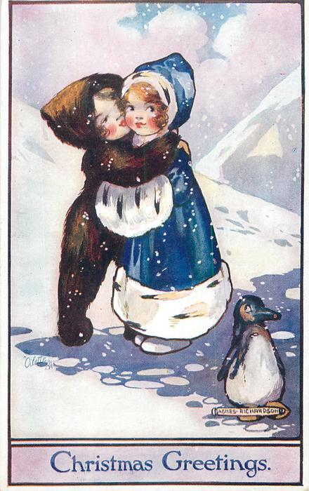 CHRISTMAS GREETINGS boy and girl embrace in snow, penguin below