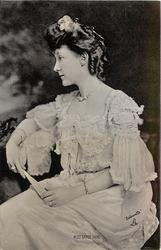 MISS GRACE LANE  seated looking to left