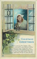 CHRISTMAS GREETINGS  woman, kitten in window