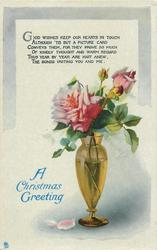 A CHRISTMAS GREETING  vase of roses